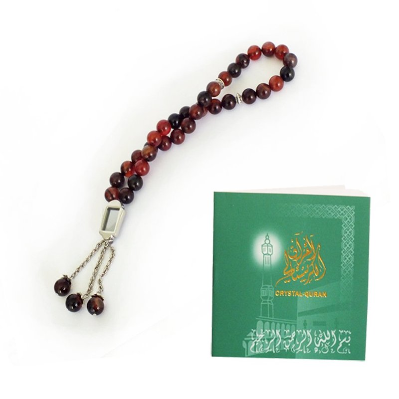 Crystal Quran on a prayer beads